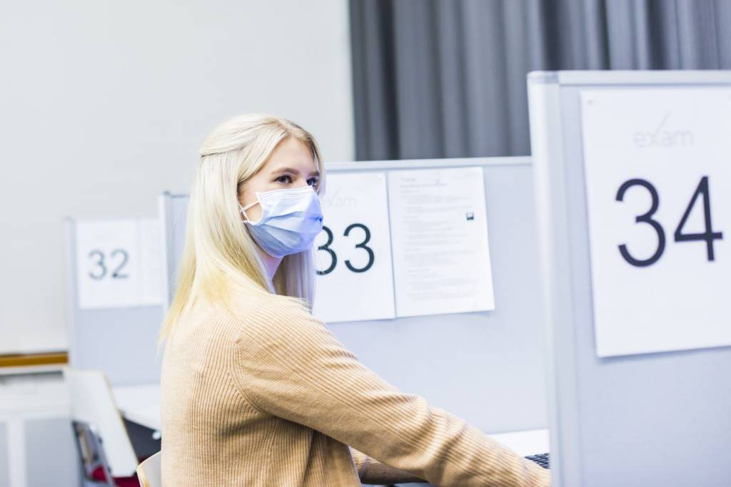 Student in a TUNI EXAM room.